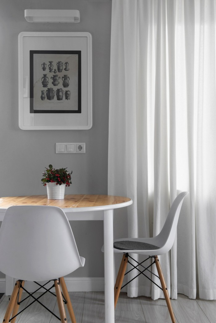 Classic-Dining-Chairs-with-Wooden-Legs-to-Match-the-Table-Top-at-Breakfast-Nook-Decorated-by-the-White-Curtain-and-Wall-Art-936x1402