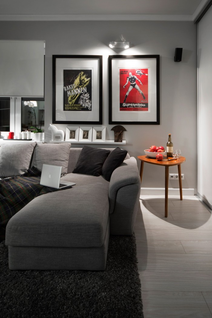 Lounge-Area-Side-View-with-Sporty-Wall-Art-Paintings-and-Wine-Table-on-the-Corner-Showing-Details-Grey-Fabric-Sofa-on-the-Dak-Rug-936x1402
